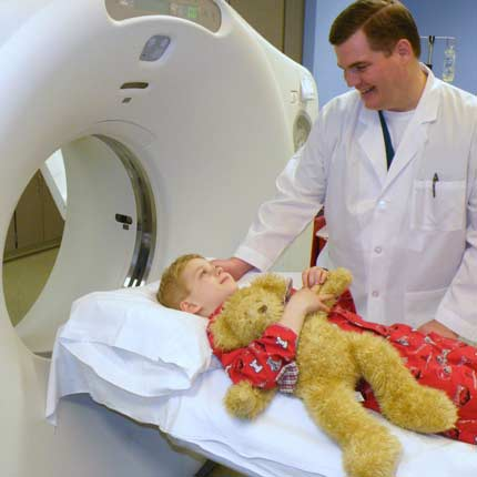 A child being prepared for a CT scan.