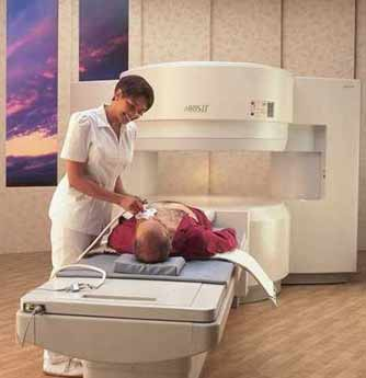 Magnetic Resonance Imaging (MRI)equipment. This is an example of an 'open' MRI unit. Open MRI models are designed to alleviate patient claustrophobia.