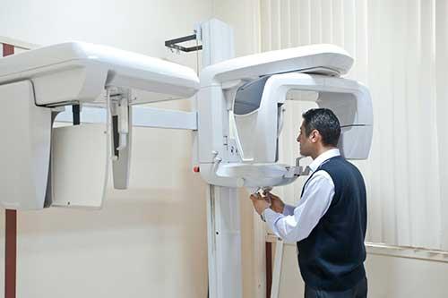 Patient undergoing panoramic x-ray exam.
