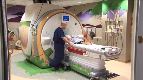 Radiologist prepping patient for magnetic resonance imaging (MRI) exam.
