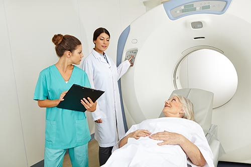 Radiologist preparing a patient for a computed tomography (CT) exam.